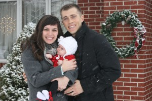 Zane with his wife and daughter. :)