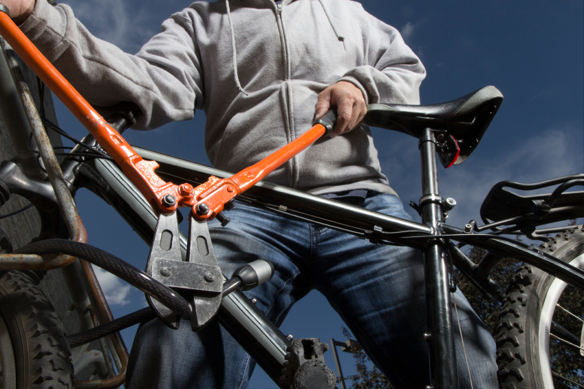 A royalty free image from sports and recreation of a bike theft in progress.