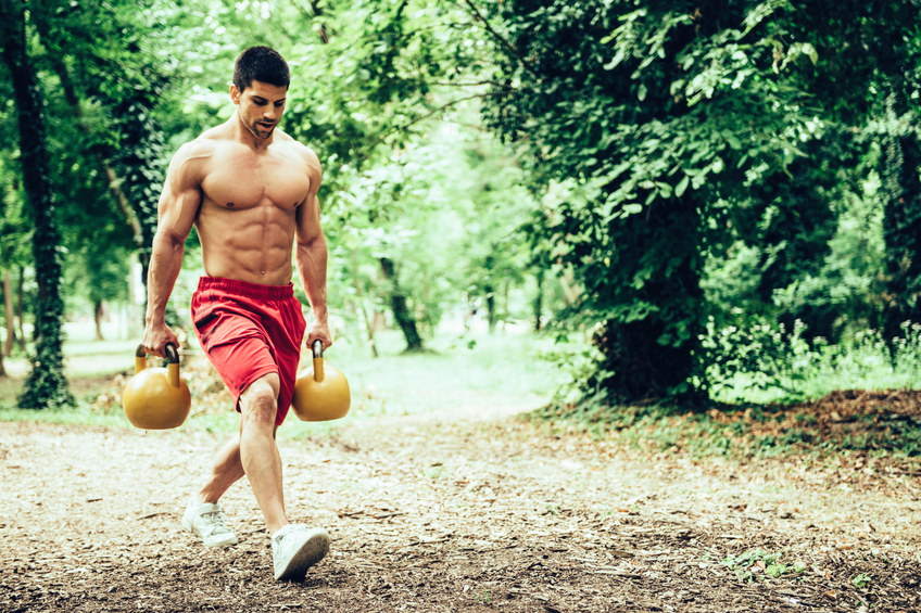 This dude is channeling his inner Thor by taking his workout to the woods