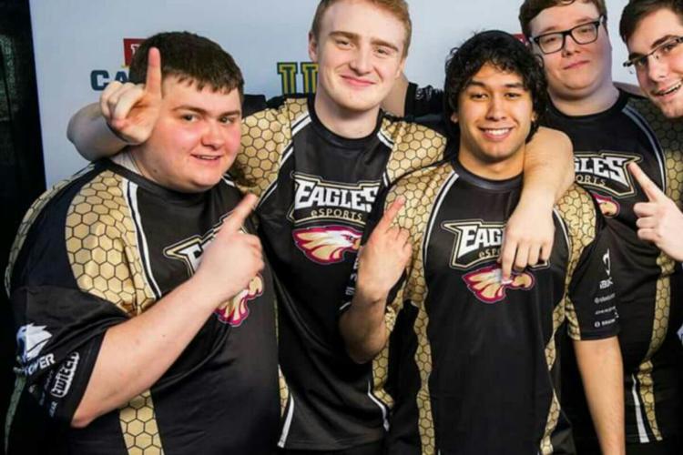 "Derek ""West Coast Carry"" Micheau celebrating with his League of Legends team"